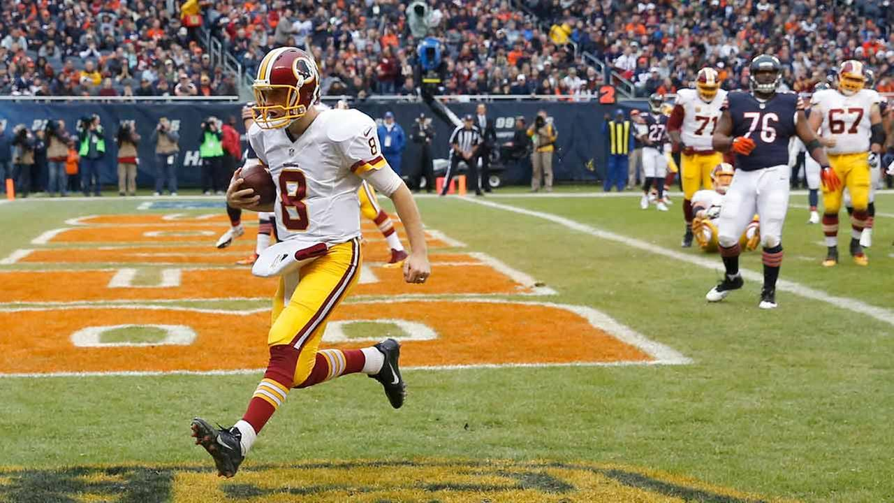 Washington Redskins quarterback Kirk Cousins runs to the end zone for a touchdown during the first half of an NFL football game against the Chicago Bears, Sunday, Dec. 13, 2015.