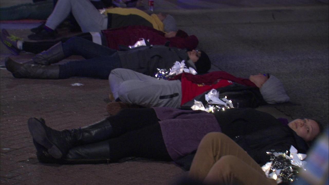 Protesters joined hands and laid down to block the intersection of Congress and Clark on Tuesday night.