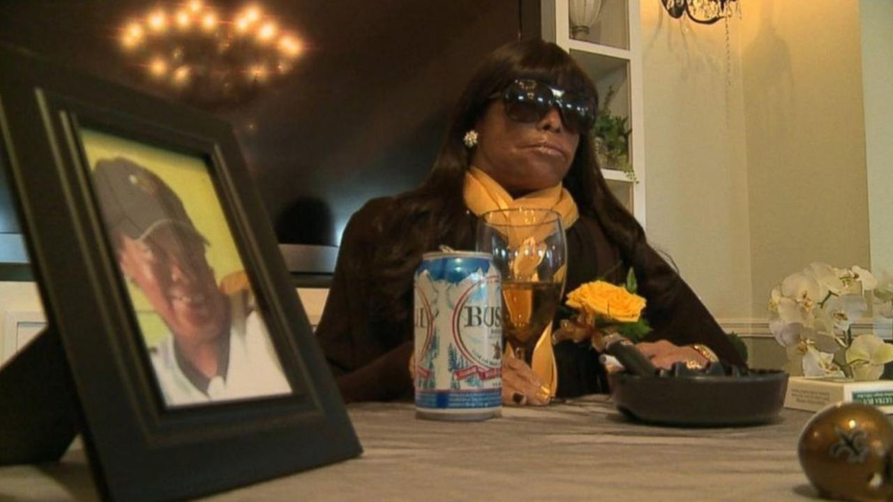Miriam Burbank is posed with some of her favorite things at an extreme funeral.