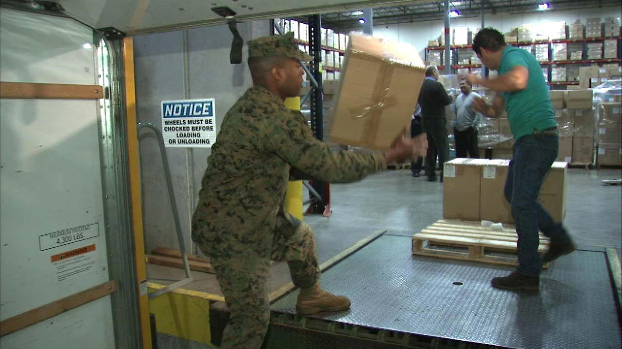 Vernon Hills marines help load trucks for Toys for Tots campaign
