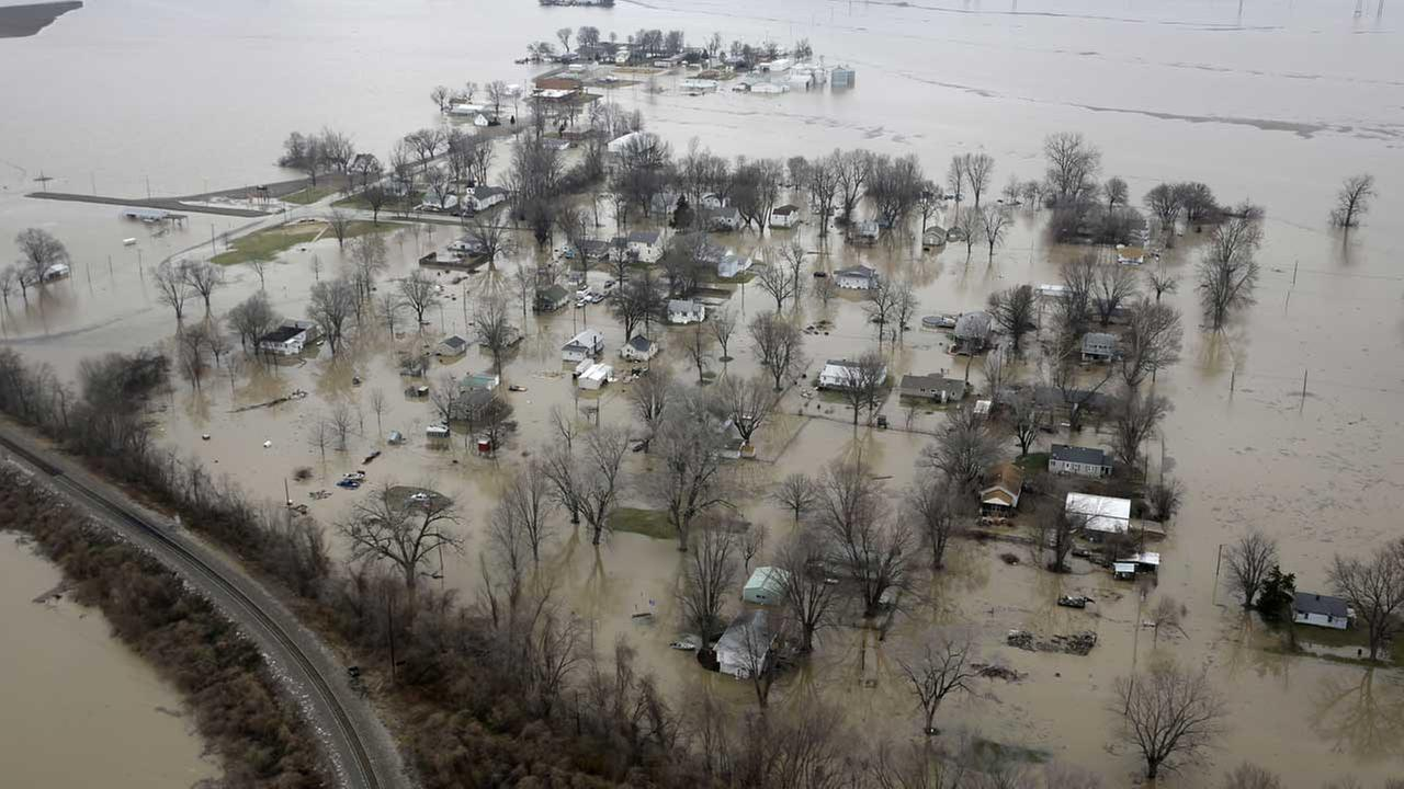 Homes are surrounded by floodwater, Wednesday, Dec. 30, 2015, in Pacific, Mo. A rare winter flood threatened nearly two dozen federal levees in Missouri and Illinois.