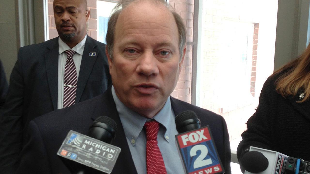 Detroit Mayor Mike Duggan speaks to reporters after visiting a handful of schools Tuesday, Jan. 12, 2016, in Detroit.