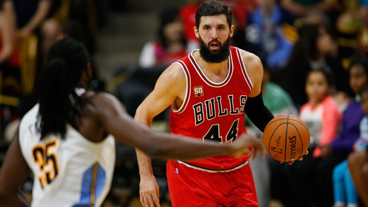 Chicago Bulls forward Nikola Mirotic brings the ball up the court against the Denver Nuggets during an NBA preseason game on Oct. 8, 2015, in Boulder, Colo.