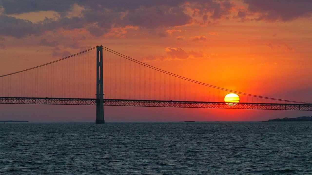 Sun sets over the Mackinac Bridge, the dividing line between Lake Michigan and Lake Huron.
