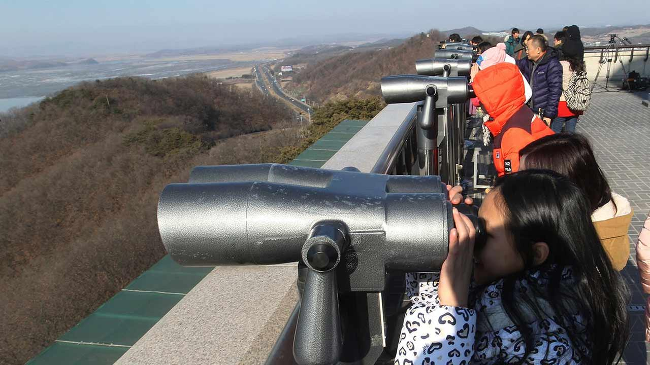 Visitors watch the North Korean side at the unification observation post near the border village of Panmunjom, in Paju, South Korea on Feb. 7, 2016.