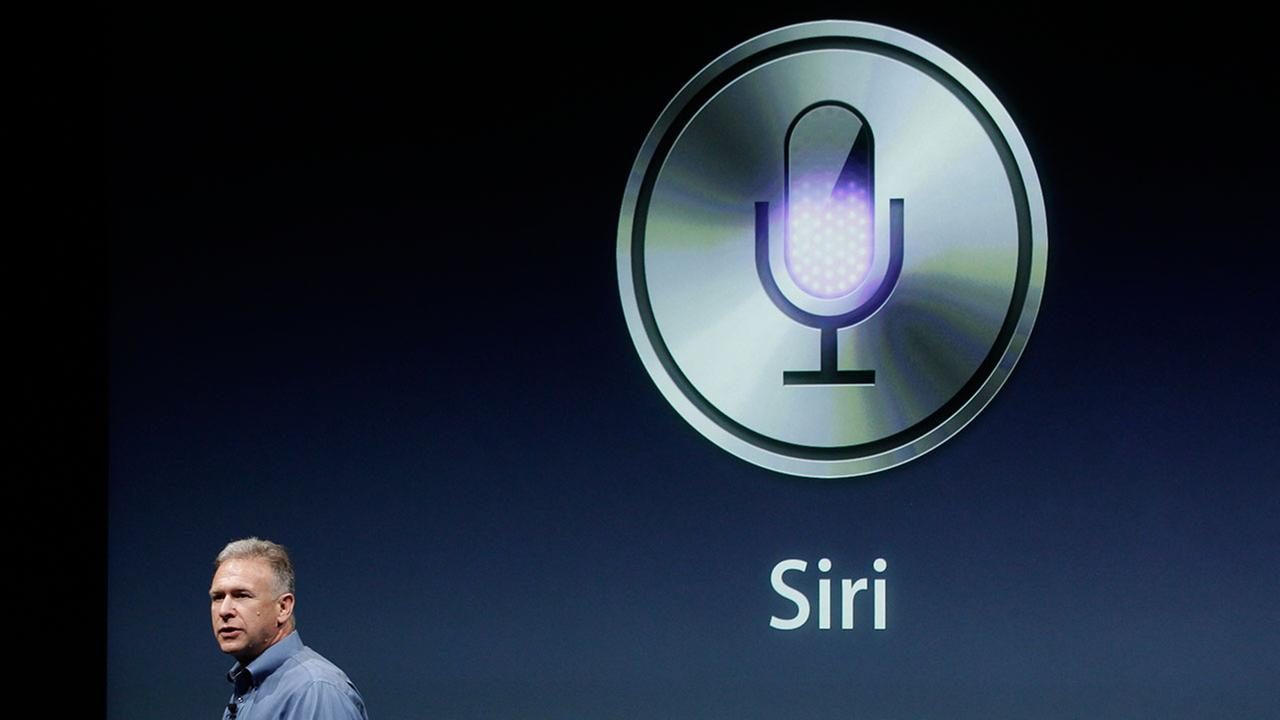 FILE - Apples Phil Schiller talks about Siri with the new Apple iPhone 4S during an announcement at Apple headquarters in Cupertino, Calif., Tuesday, Oct. 4, 2011.