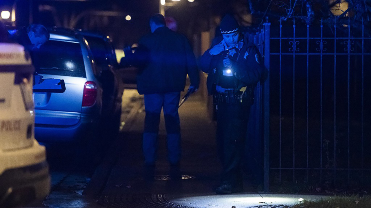 Chicago police investigate the scene where a person was shot Sunday night in the 6800-block of South Sangamon, in the Englewood neighborhood.