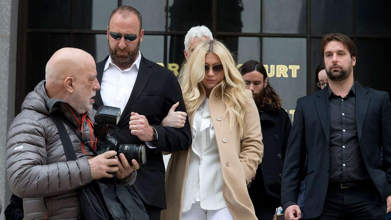 Pop star Kesha, center, leaves Supreme court in New York on Feb. 19, 2016.