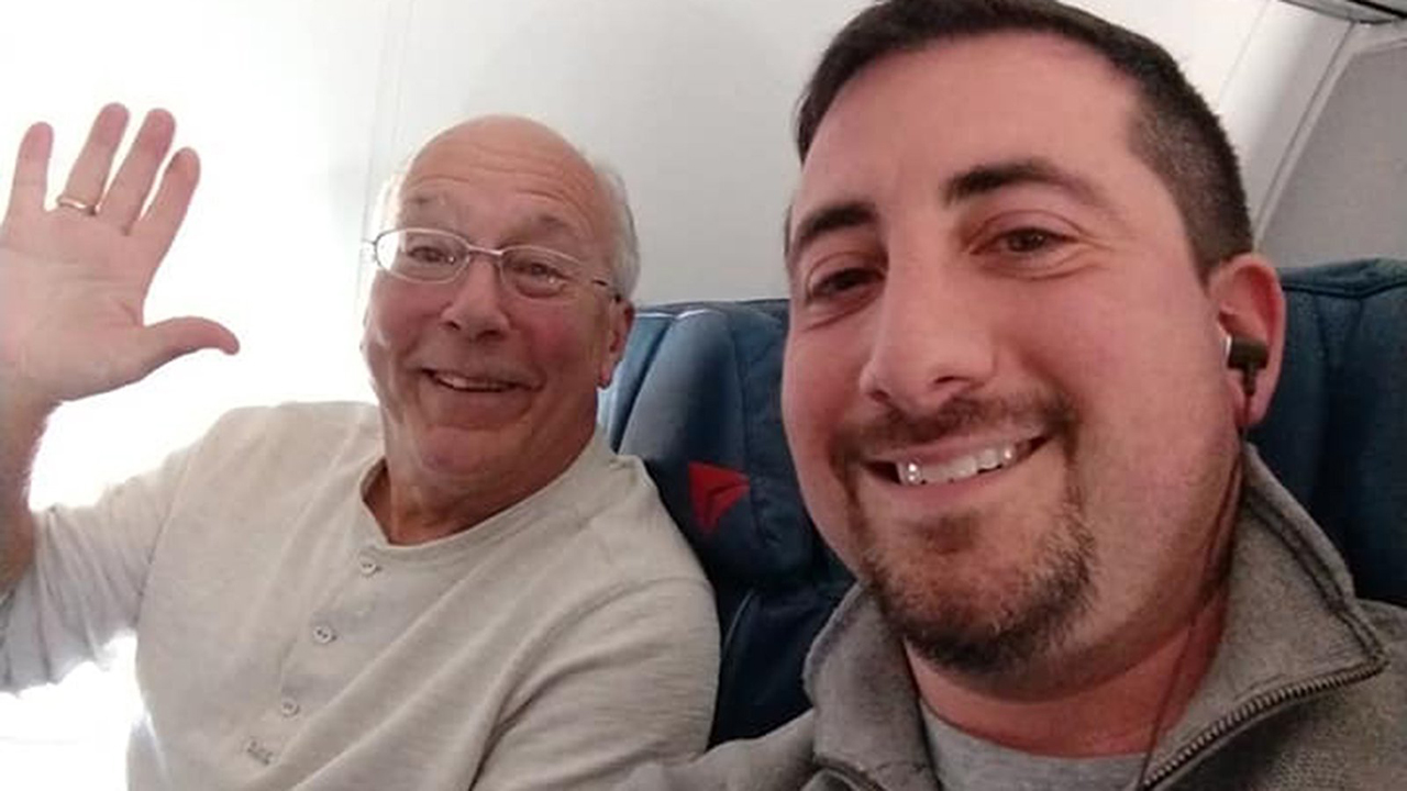 Beaming father Hal Vaughan, left, sits next to fellow passenger Mike Levy on one of his daughters holiday flights.