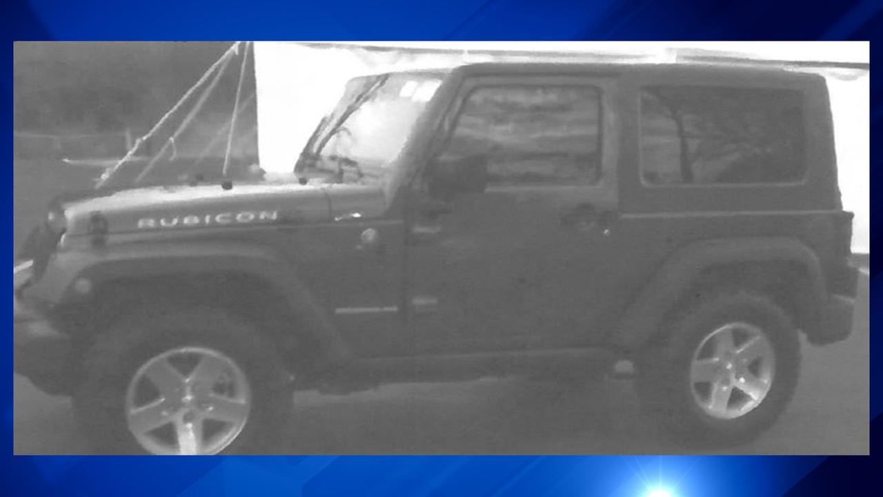Police are looking for the driver of this dark green SUV, possibly a Jeep Rubicon, which has a spare tire on the back and Rubicon printed on hood.