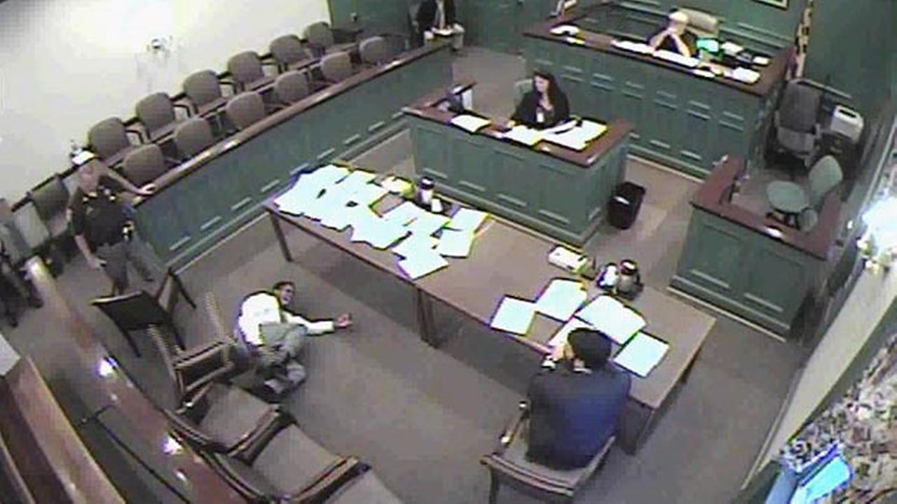 This framegrab from video shows Saamir Jhaled Khaleel Kingali on the floor after Judge Robrt C. Nalley ordered a deputy to activate a stun-cuff on Kingali.