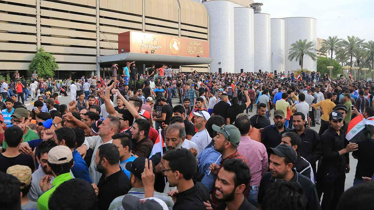 Supporters of Shiite cleric Muqtada al-Sadr gather outside parliament in Baghdads Green Zone, Saturday, April 30, 2016.