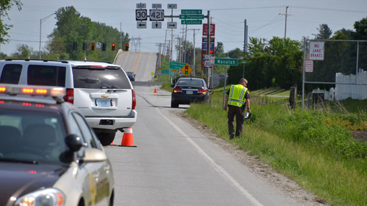 Authorities investigate after a womans body was found along U.S. 421 in southern La Porte County, Ind., on May 25, 2016.