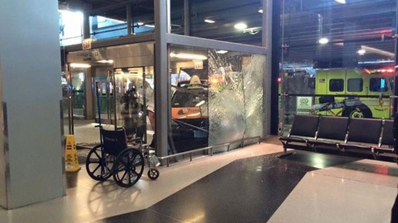 Taxi crashes into doors at O'Hare