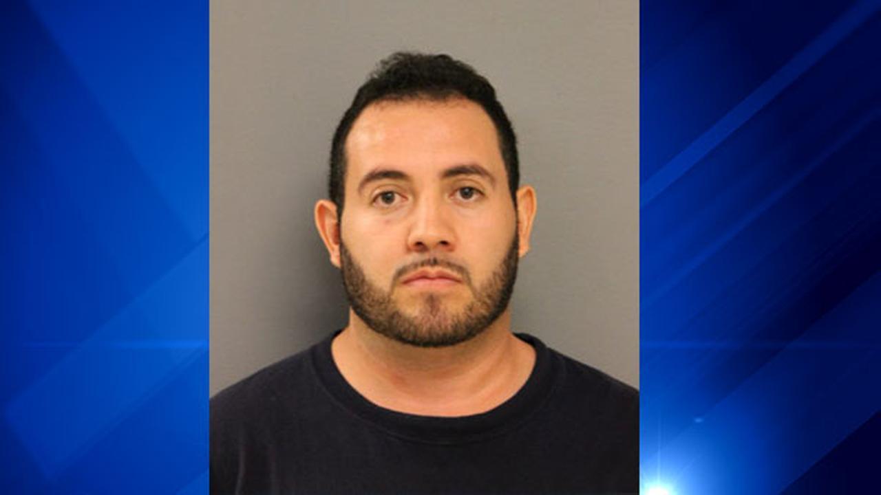 Mugshot of busboy accused of secretly filming a customer inside a restaurant bathroom.