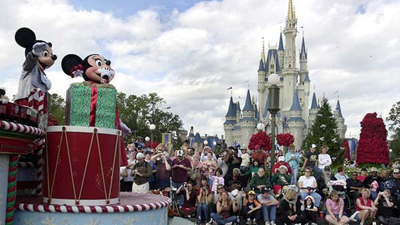 ** FILE ** Visitors gather in front of Cinderellas castle during the Christmas parade at Walt Disney Worlds Magic Kingdom in Lake Buena Vista, Fla., Dec. 22, 2004.