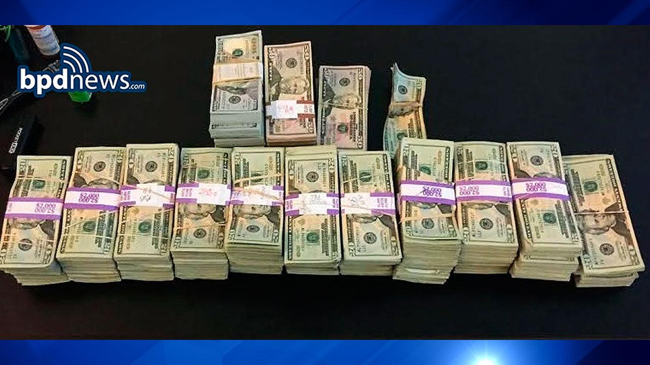 In this photo released July 5, 2016 by the Boston Police Department, stacks of money totaling about $187,000 that were left in a taxi are displayed in Boston.