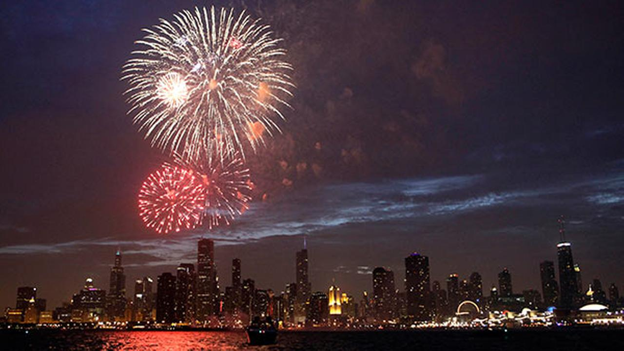 Fireworks explode over Lake Michigan in downtown Chicago.