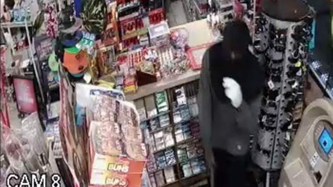 A surveillance image of one of the suspects in an armed robbery at a Waukegan gas station.