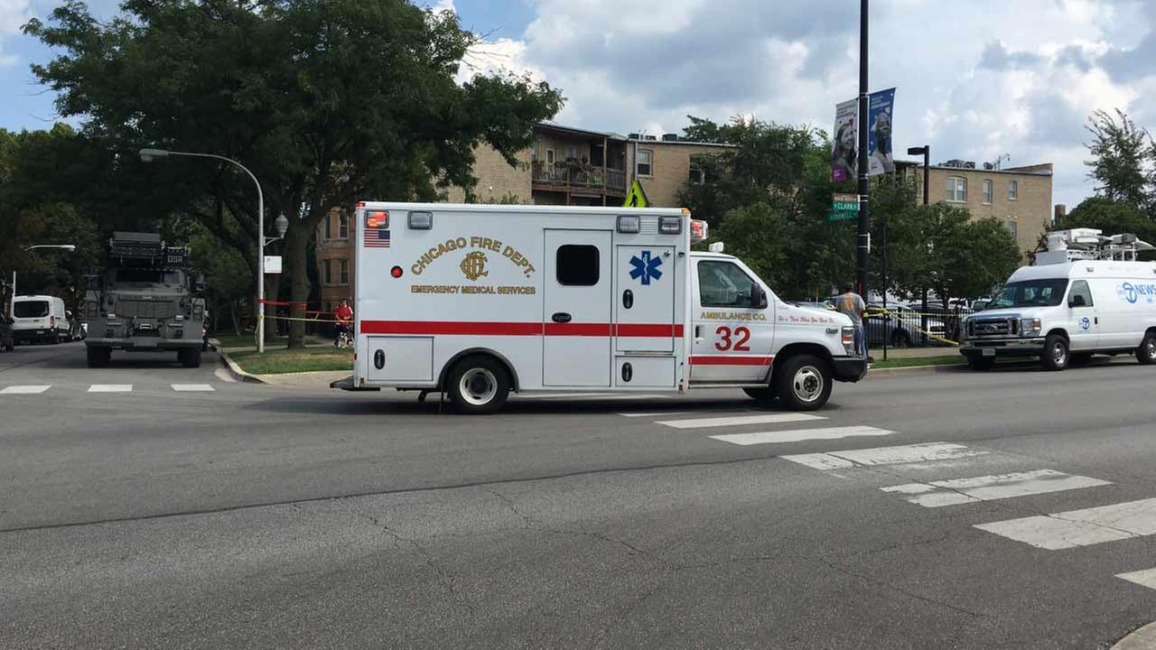 An ambulance leaves the scene of a barricade situation in Rogers Park.