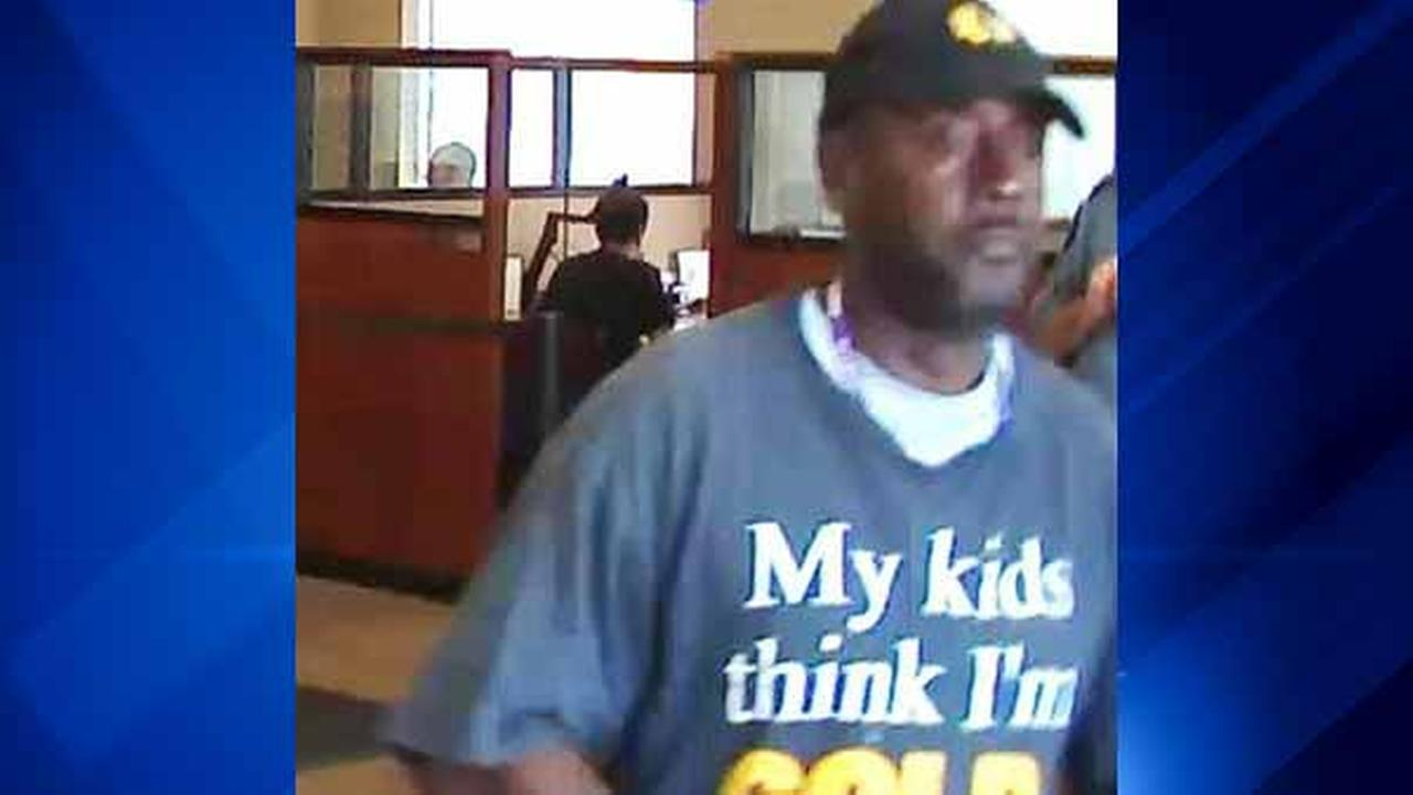 Police are offering a reward for anyone with information leading to a man who robbed six suburban banks.