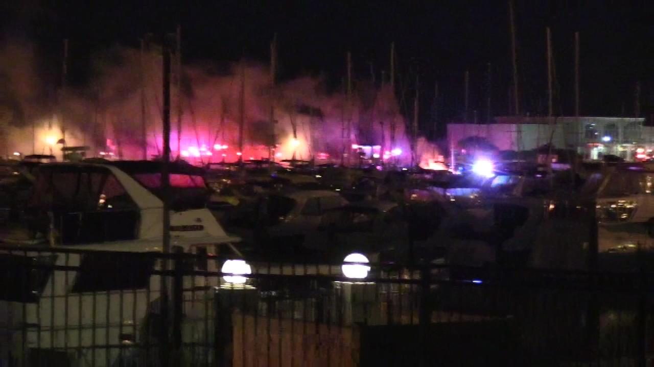 A boat on fire in Burnham Harbor.