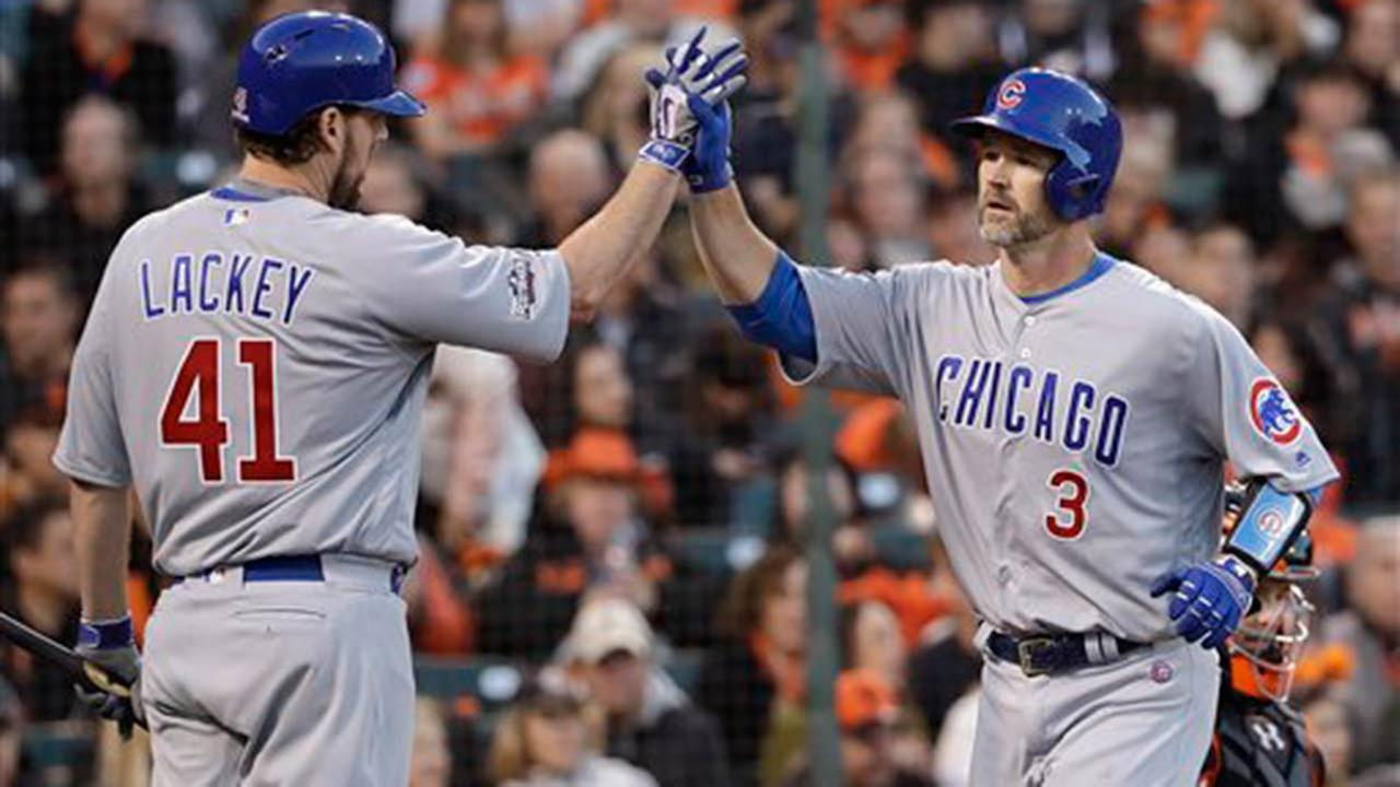 Chicago Cubs David Ross (3) is congratulated by John Lackey after hitting a solo home run against the San Francisco Giants.