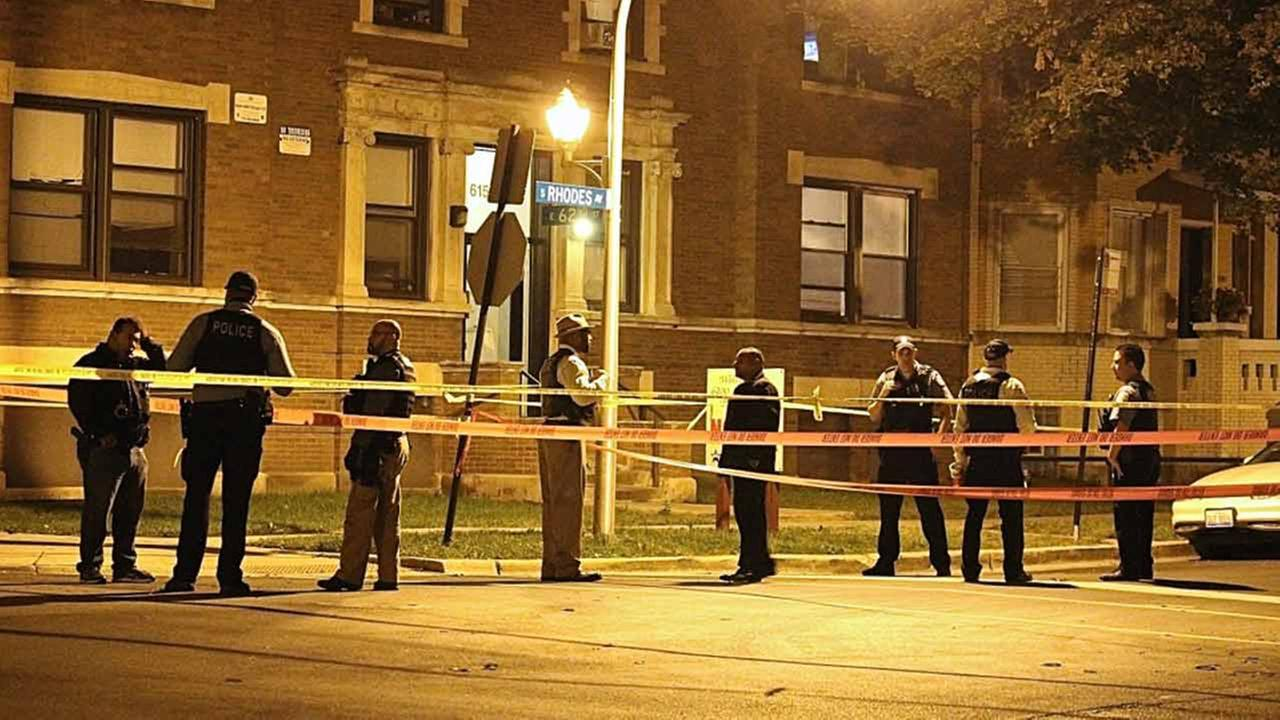 Police on the scene of a homicide early Saturday in Woodlawn.