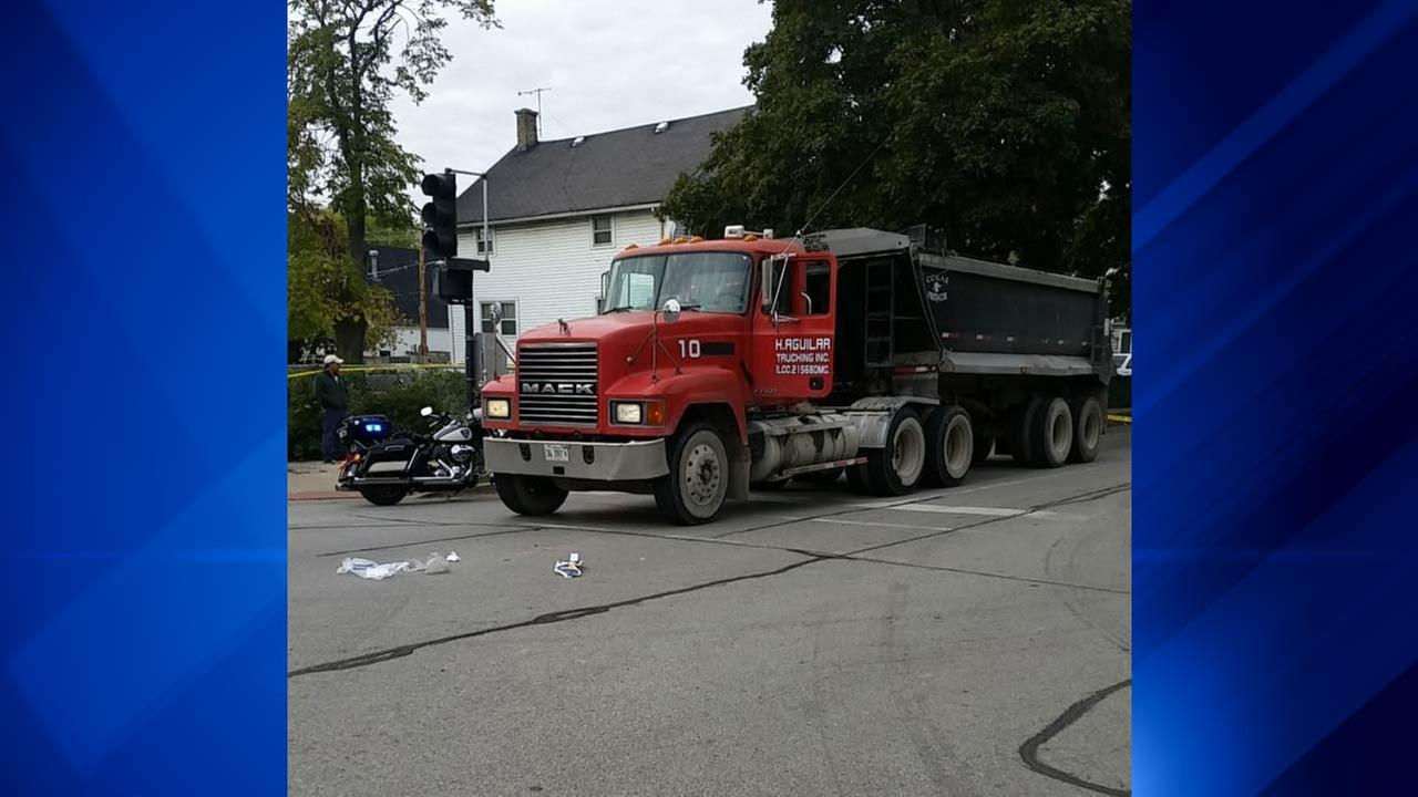 An Evanston police officer was injured after being hit by a dump truck Saturday morning.