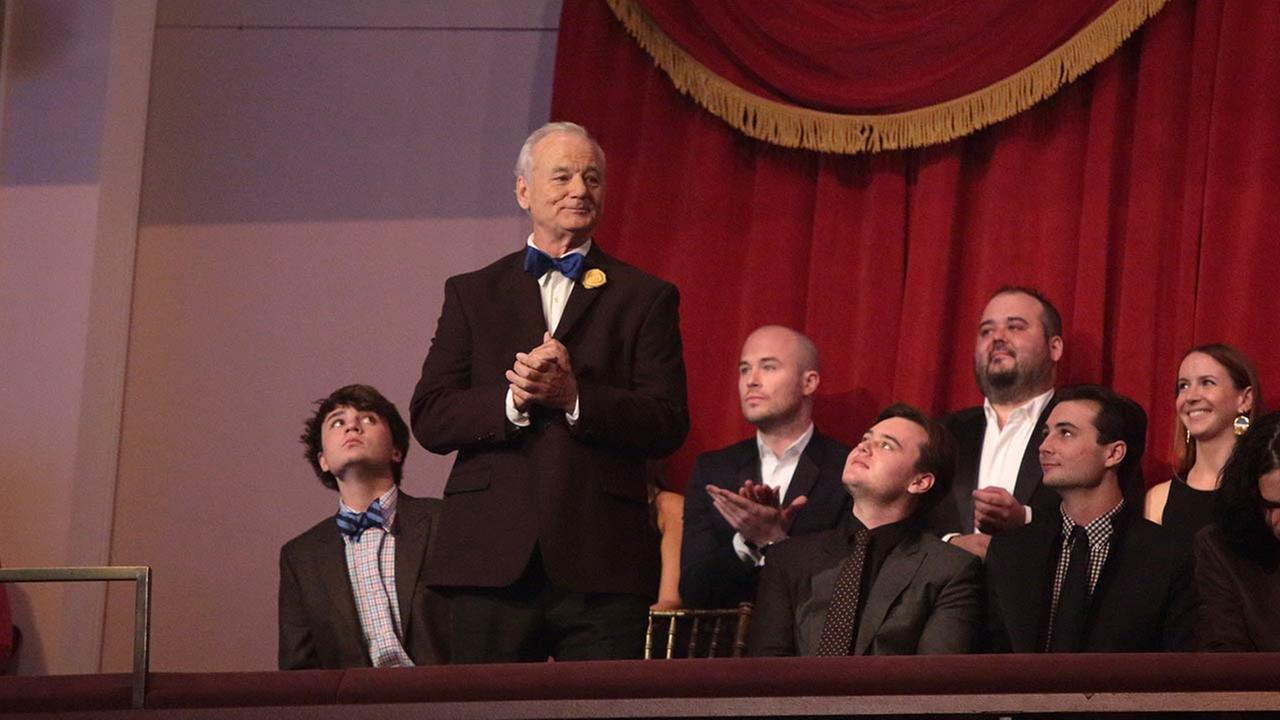 Bill Murray, standing, is honored with the Mark Twain Prize for American Humor at the Kennedy Center for the Performing Arts.