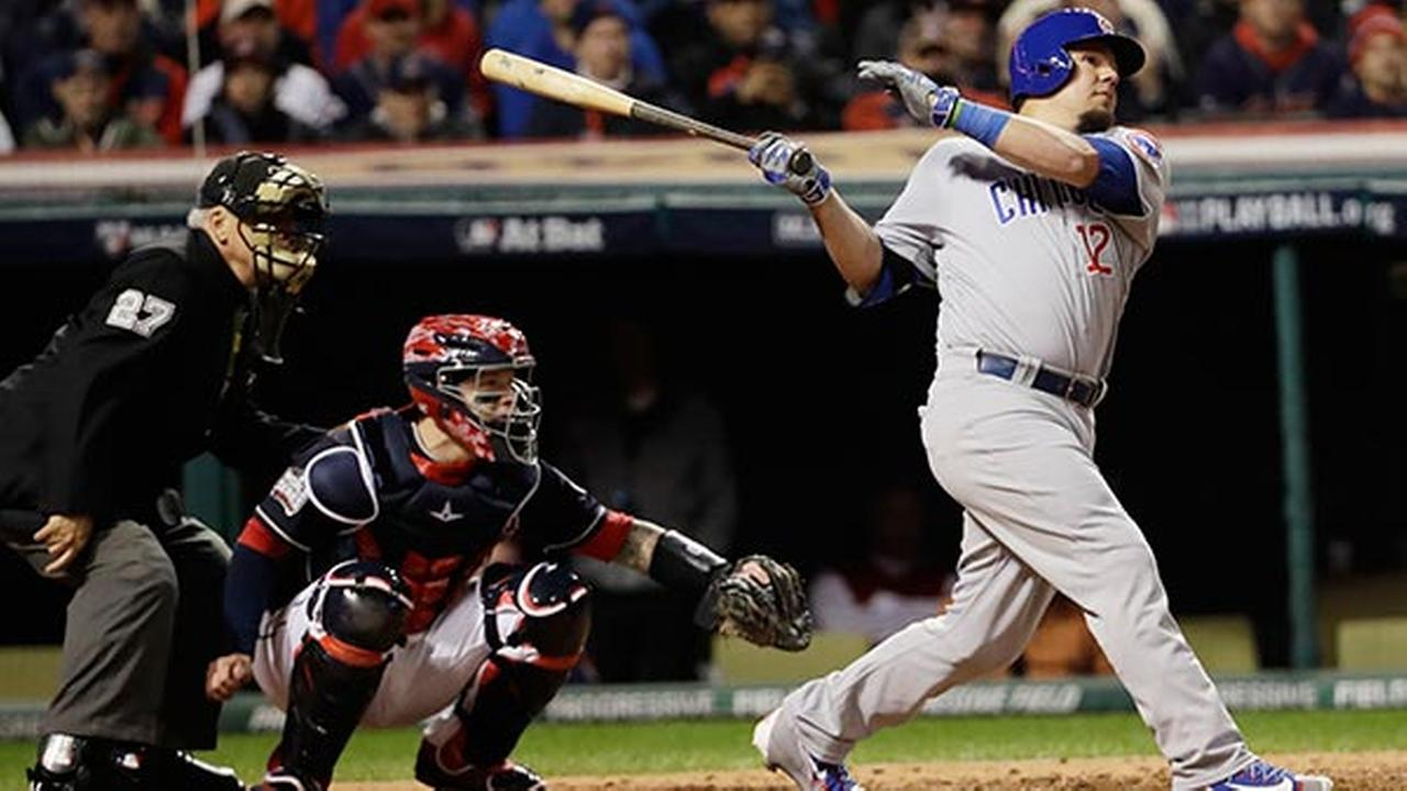 Chicago Cubs Kyle Schwarber hits a double during the fourth inning of Game 1 of the Major League Baseball World Series against the Cleveland Indians Tuesday, Oct. 25, 2016.
