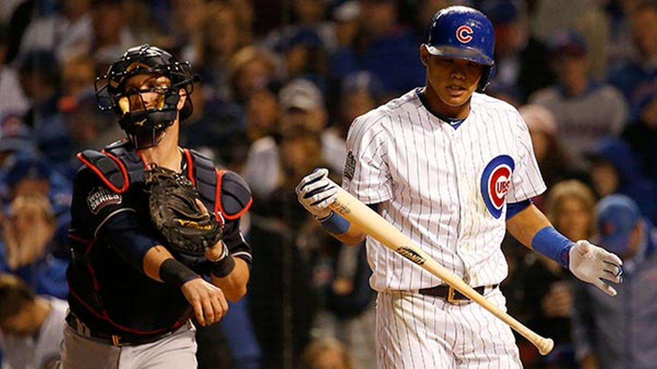 Chicago Cubs Addison Russell, right, reacts after striking out during the eighth inning of Game 3 of the Major League Baseball World Series against the Cleveland Indians.