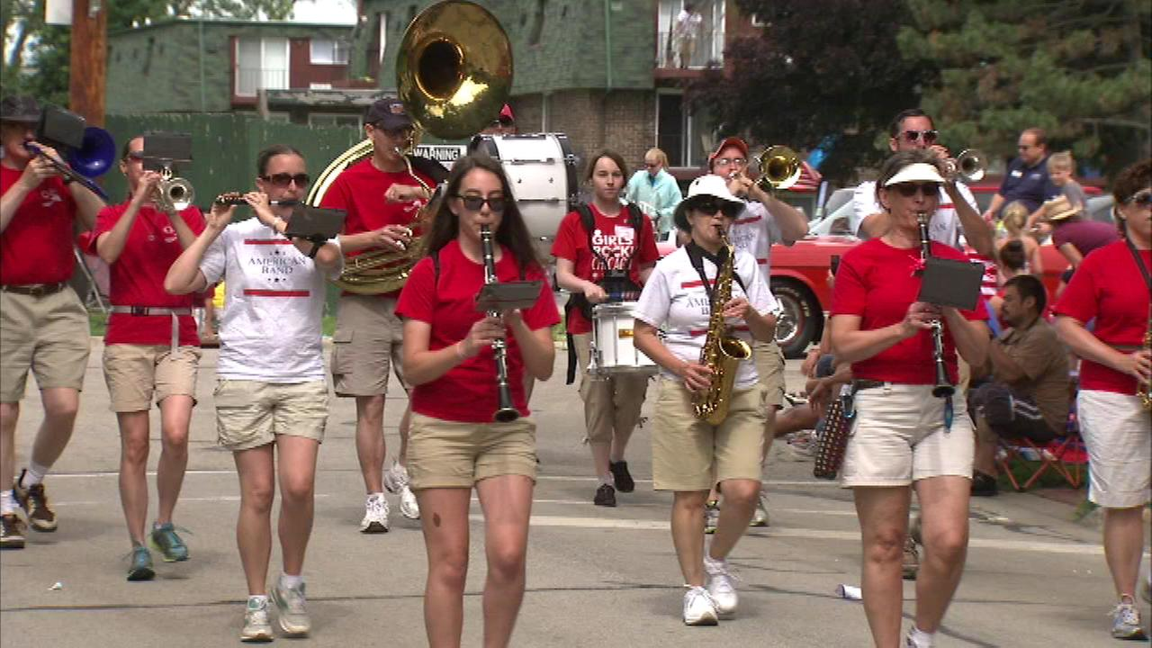 Hundreds of people gather to celebrate Independence Day weekend at a parade in northwest suburban Palatine.