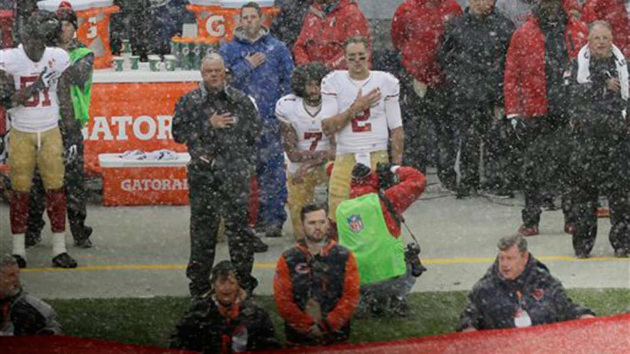 Colin Kaepernick kneels during national anthem