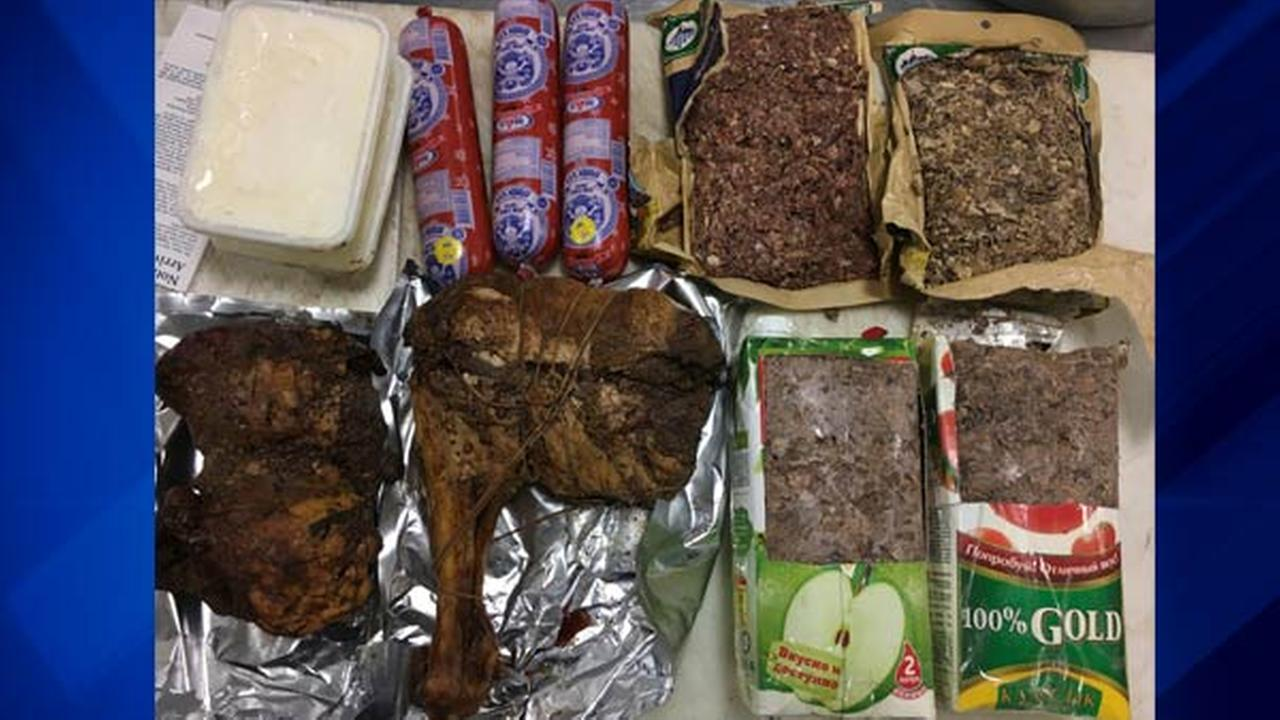 This undated photo provided by the U.S. Department of Homeland Security shows horse meat, including 13 pounds of horse genitals, from two women arriving from Mongolia at Dulles.