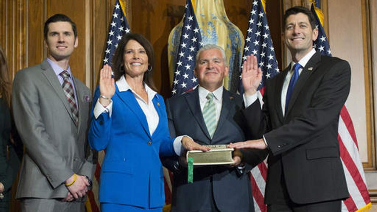 House Speaker Paul Ryan of Wis. administers the House oath of office to Rep. Cheri Bustos, D-Ill., during a mock swearing in ceremony on Capitol Hill in Washington.