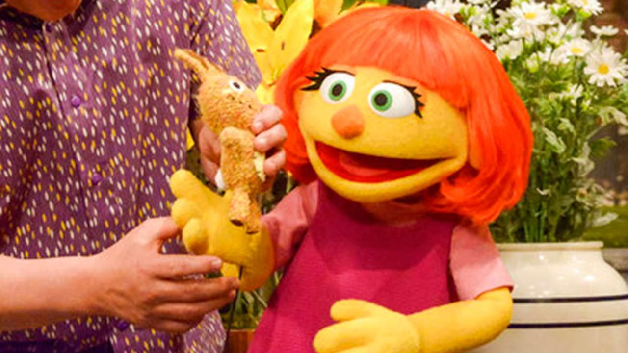 This image released by Sesame Workshop shows Julia, a new autistic muppet character debuting on the 47th Season of Sesame Street, on April 10, 2017.