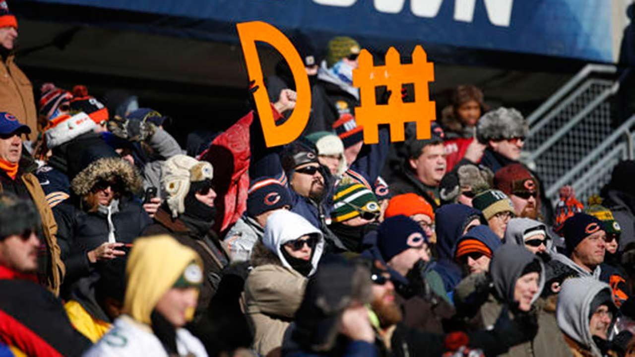 A fan at Soldier Field holds up a sign during the first half of an NFL football game between the Chicago Bears and Green Bay Packers Sunday, Dec. 18, 2016, in Chicago.