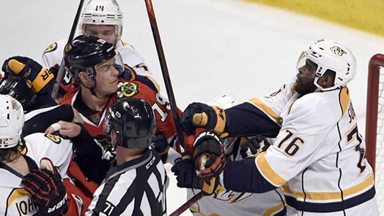 Chicago Blackhawks center Jonathan Toews and Nashville Predators defenseman P.K. Subban push each other during Game 1 of a first-round NHL hockey playoffs in Chicago.