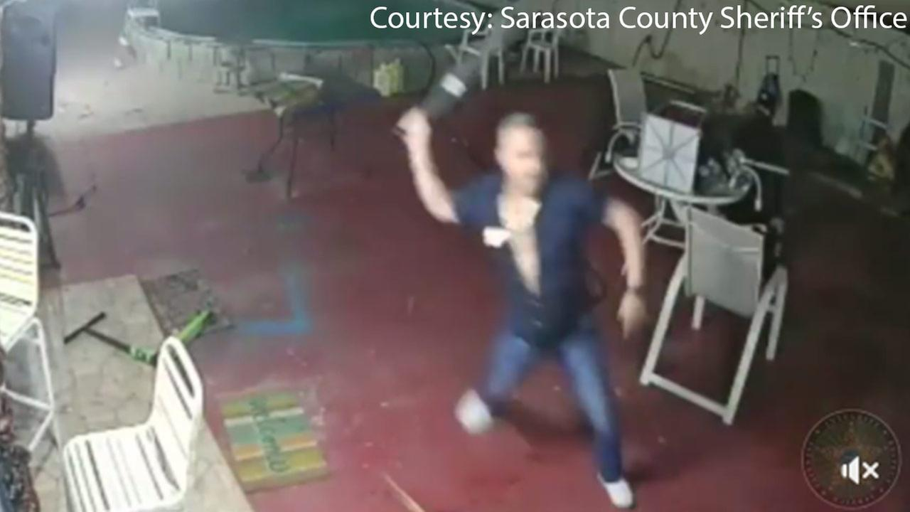 Police said surveillance video shows a Florida man fuse a machete to fend off an attempted robbery.