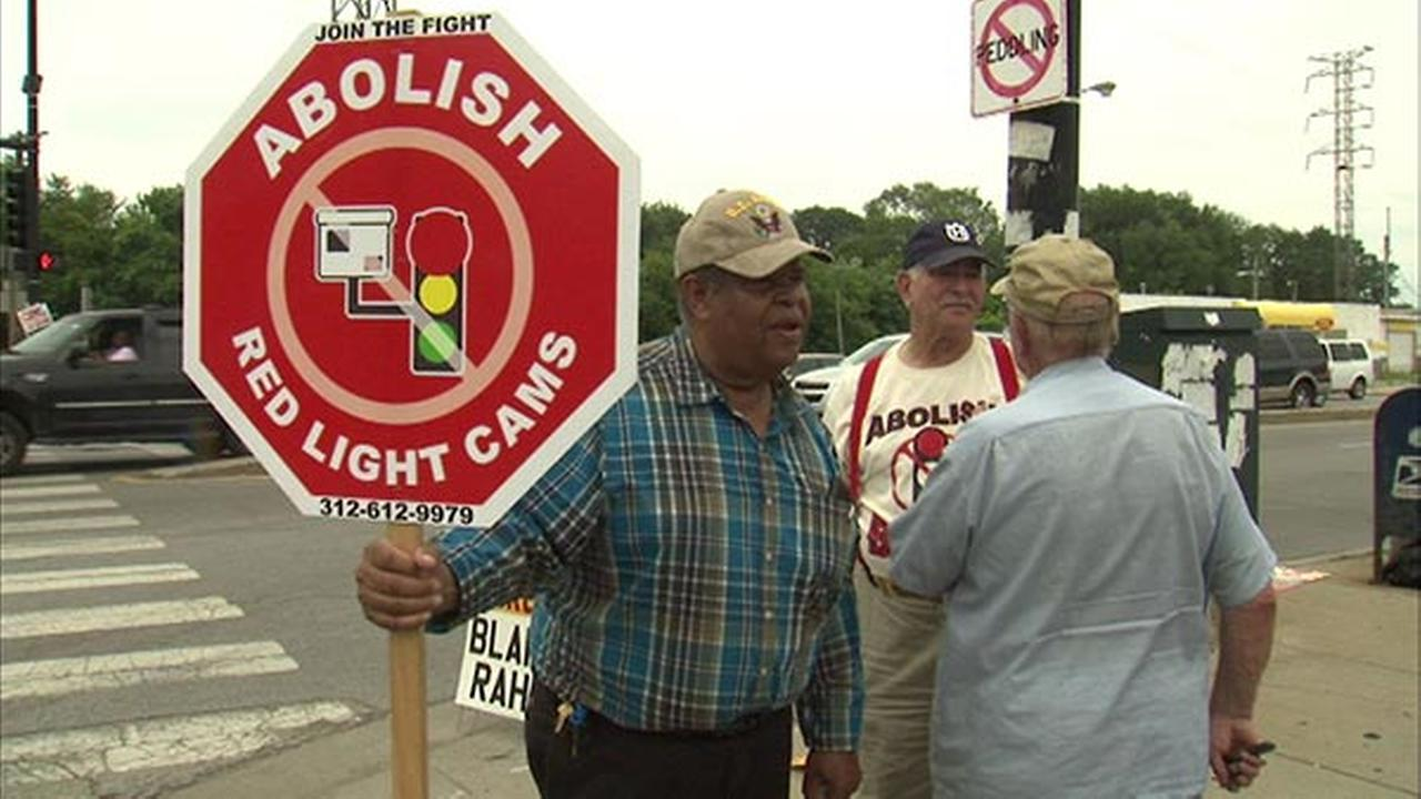 Protesters rally against red light cameras