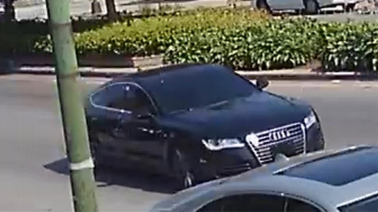 A surveillance image of a black, four-door Audi police said was used int he shooting of a South Side community activist in July.