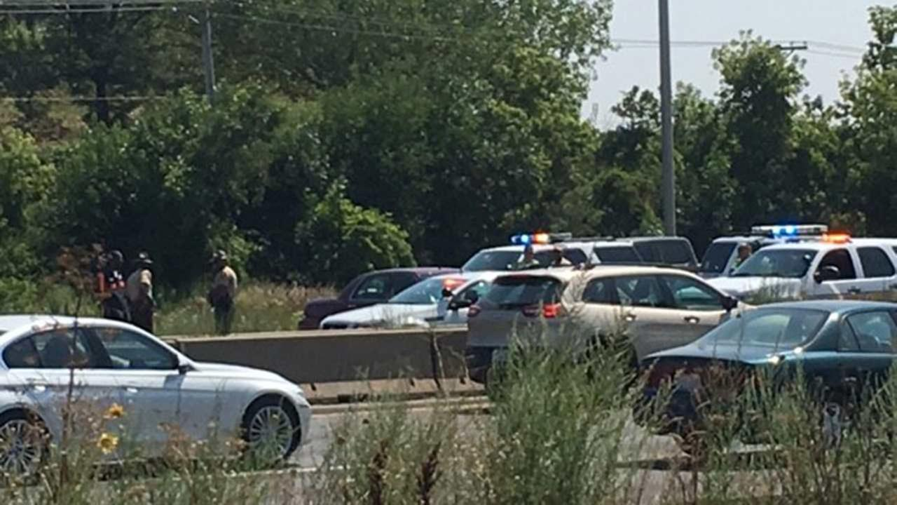 Police investigate a crash on the Bishop Ford Freeway Saturday.