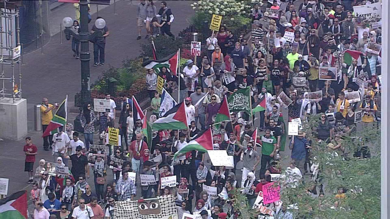 Pro-Palestinian marchers held a rally at Michigan Avenue and Congress before they marched to Federal Plaza Sunday afternoon.