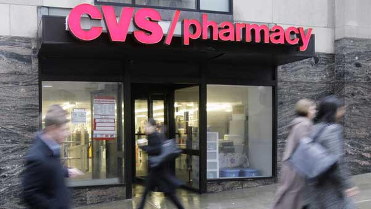 People walk past a CVS pharmacy in downtown Chicago.