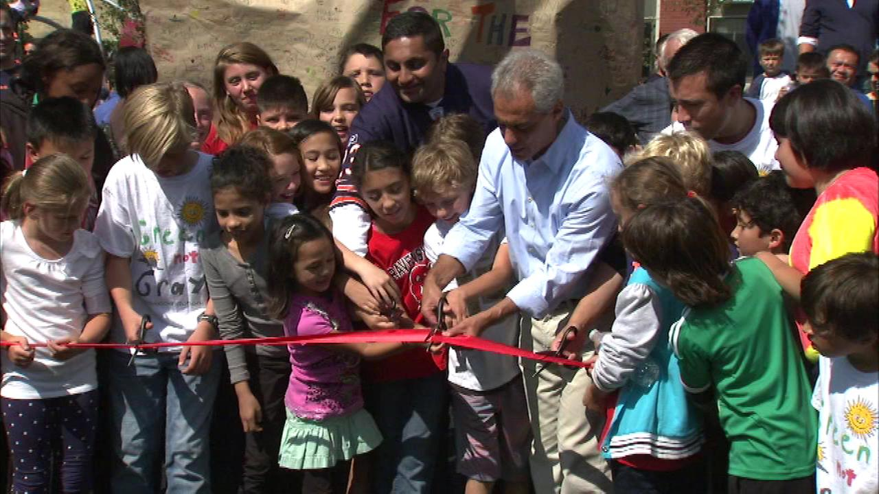 Kids at a North Side elementary school help dedicate their newly remodeled playground.
