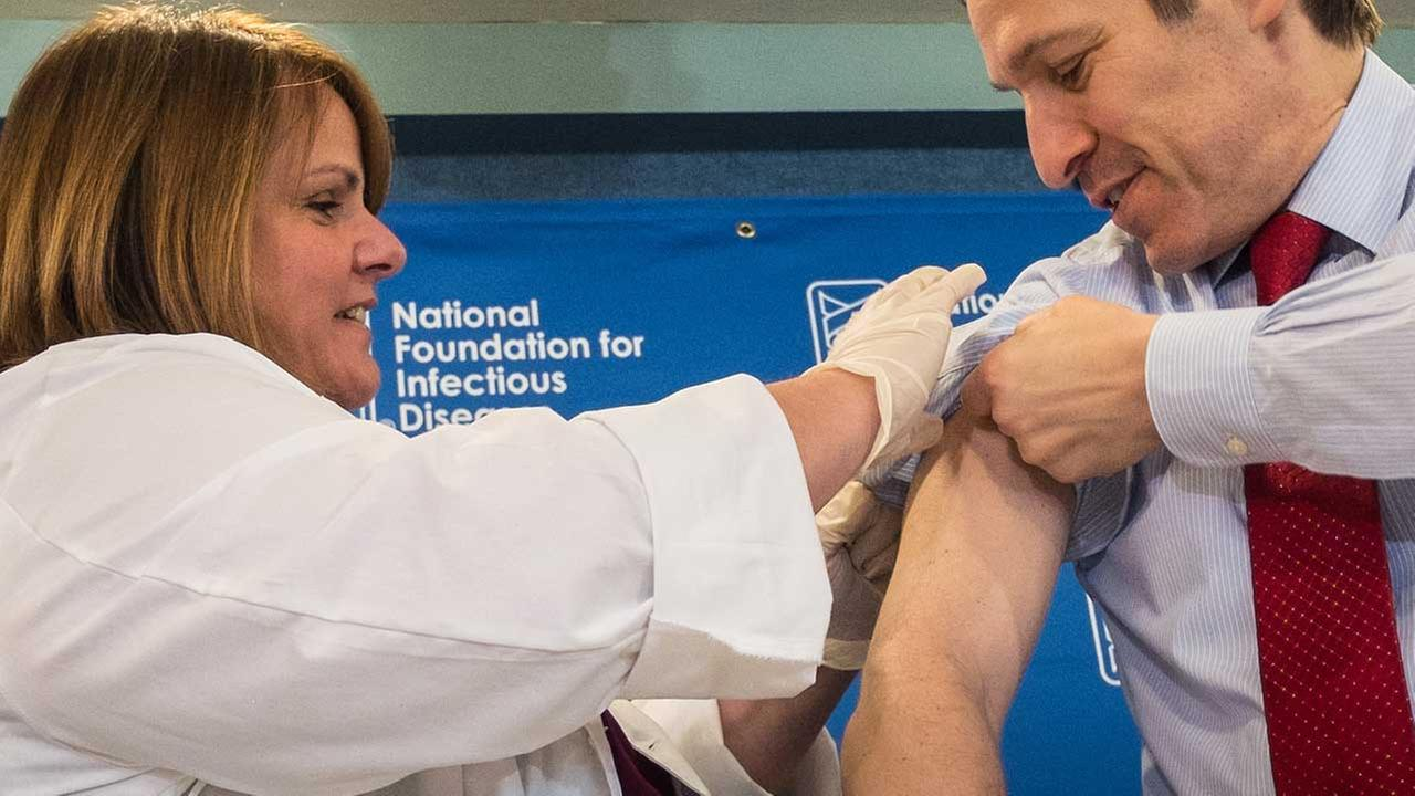 Dr. Thomas Frieden, director of the Centers for Disease Control and Prevention, receives a flu shot.