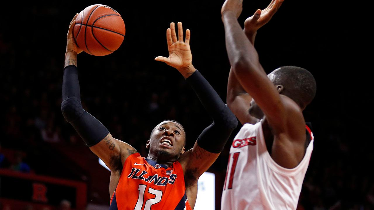 Illinois forward Leron Black (12) drives to the basket past Rutgers forward Eugene Omoruyi (11) during the first half of an NCAA college basketball game in February 2018.
