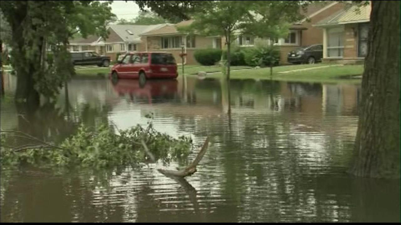 Two Chicago suburbs will get millions of dollars to deal with the aftermath of severe flooding.