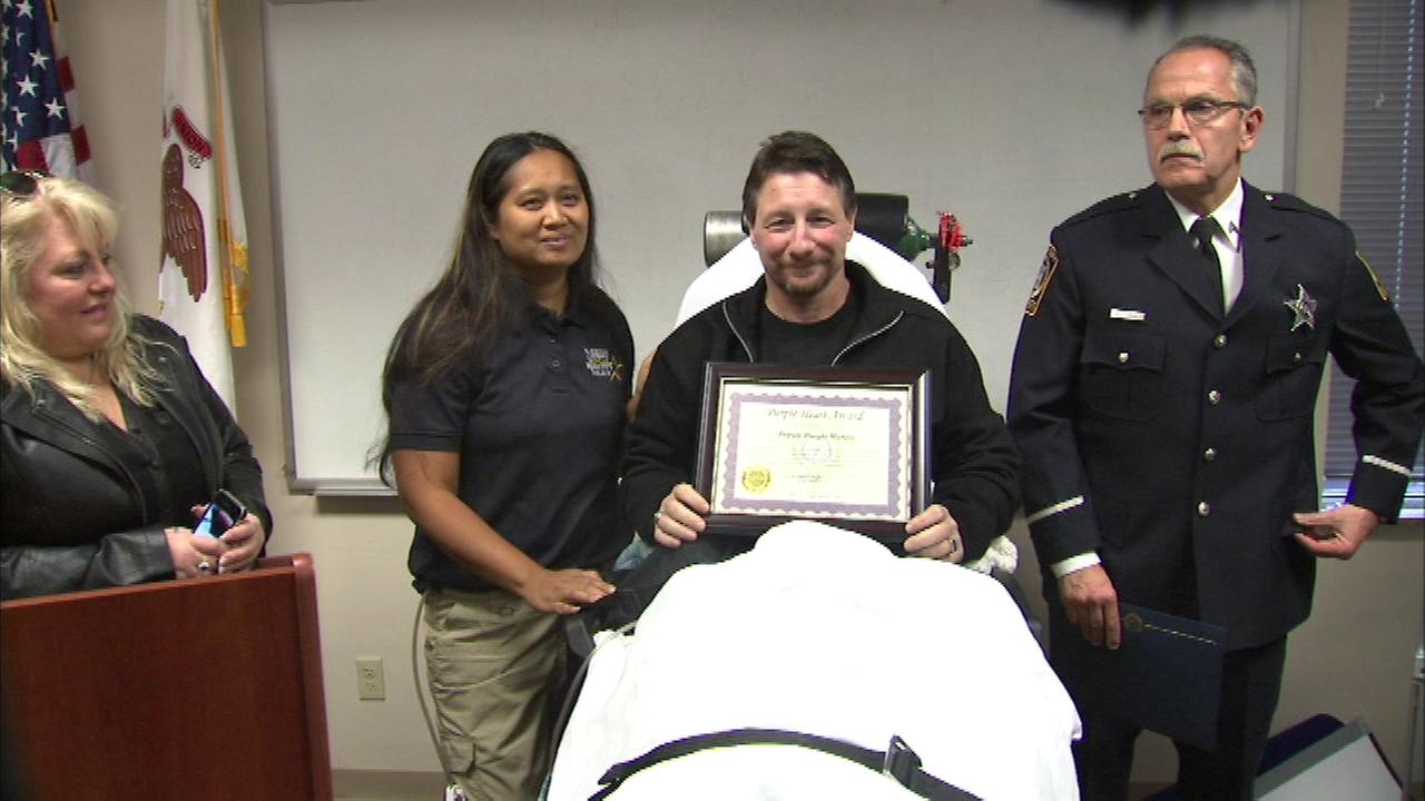 Deputy Dwight Maness, shot in the line of duty, was honored with the Purple Heart award.